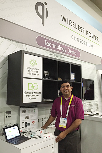 Arun Kumar, ROHM Applications Engineer, demonstrates ROHM's Qi-certified wireless charging solution at the WPC booth during CES2016.